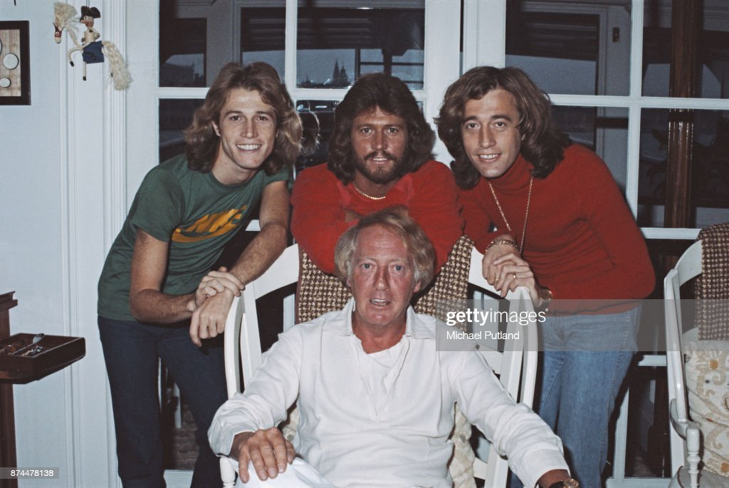 British singers Andy Gibb (1958 - 1988), Barry Gibb, and Robin Gibb (1949 - 2012) with Australian music entrepreneur Robert Stigwood (1934 - 2016), February 1979.