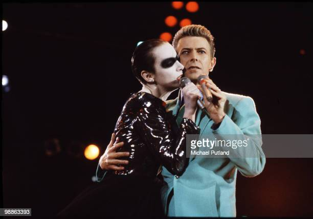 British singers Annie Lennox and David Bowie performing a duet at the Freddie Mercury Tribute Concert for AIDS Awareness Wembley Stadium London 20th...