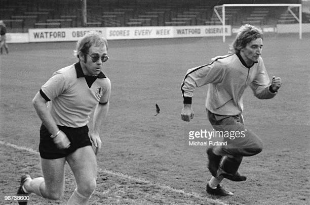 British singers Elton John Rod Stewart training at Watford Football Club London November 1973