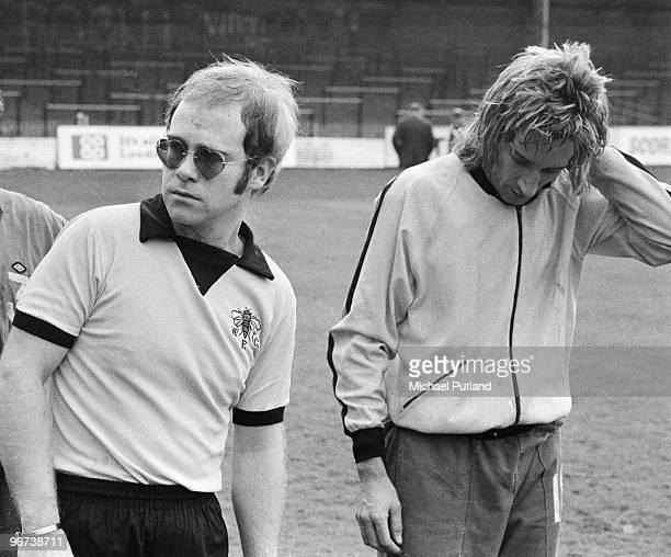 British singers Elton John Rod Stewart training at Watford Football Club London November 1973