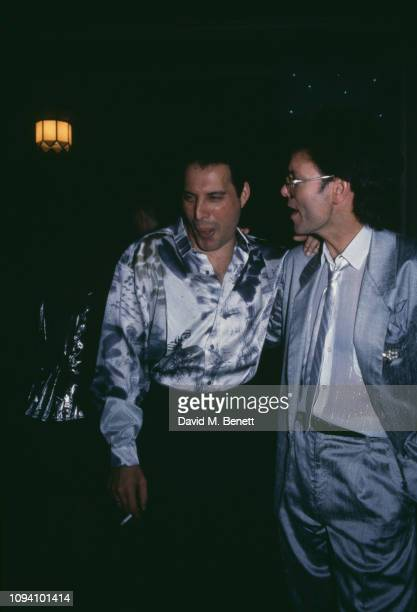 British singers Freddie Mercury and Cliff Richard at a birthday party for drummer and businessman Dave Clark, 15th December 1987.