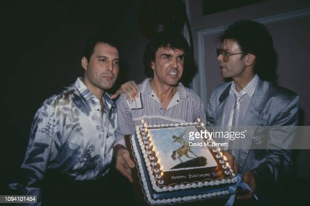British singers Freddie Mercury and Cliff Richard at birthday party for drummer and businessman Dave Clark , 15th December 1987.