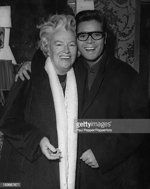 British singers Gracie Fields and Cliff Richard backstage during rehearsals for the Royal Variety Performance at the London Palladium 2nd November...