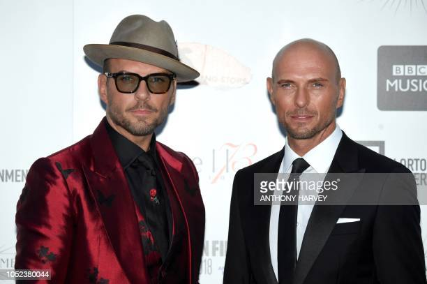 British singers Matt Goss and Luke Goss of the band Bros pose upon arrival for the UK premiere of the film 'Bros After The Screaming Stops' during...