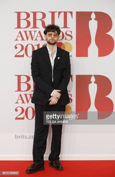 British singersongerwriter Tom Grennan poses on the red carpet on arrival for the BRIT Awards 2018 in London on February 21 2018 / AFP PHOTO / Tolga...