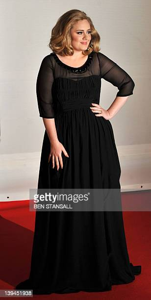 British singer-songwriter Adele poses on the red carpet arriving at the BRIT Awards 2012 in London on February 21, 2012. AFP PHOTO / BEN STANSALL
