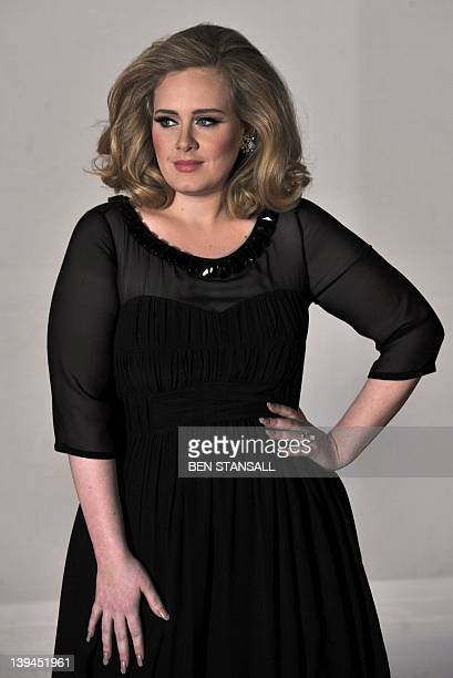 British singersongwriter Adele poses on the red carpet arriving at the BRIT Awards 2012 in London on February 21 2012 AFP PHOTO / BEN STANSALL