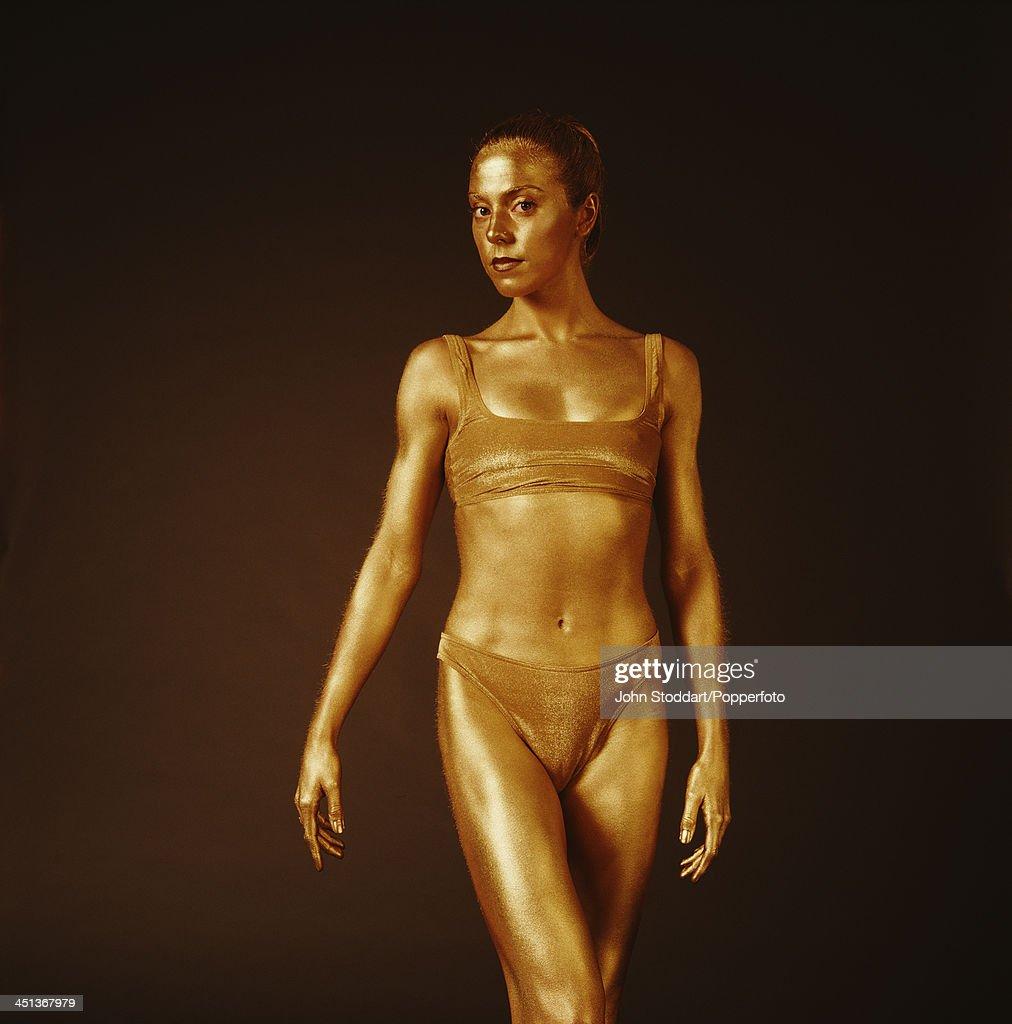 British singer-songwriter and actress Melanie C (Melanie Chisholm) posing wearing gold body paint, circa 1996.