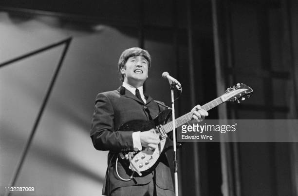 British singer-songwriter and musician John Lennon of The Beatles performing on stage at the London Palladium, UK, 13th October 1963.