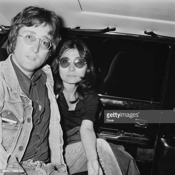 British singersongwriter and musician John Lennon with wife Yoko Ono at Heathrow airport London UK 10th May 1971