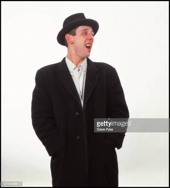 British singersongwriter and musician Shane MacGowan wearing a black overcoat and a black homburg hat during a studio portrait session in London...