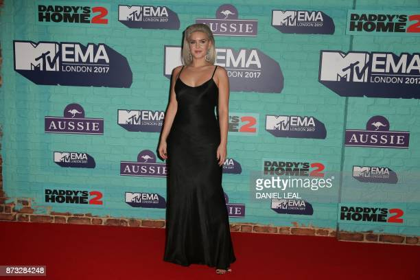 British singersongwriter AnneMarie poses on the red carpet arriving to attend the 2017 MTV Europe Music Awards at Wembley Arena in London on November...