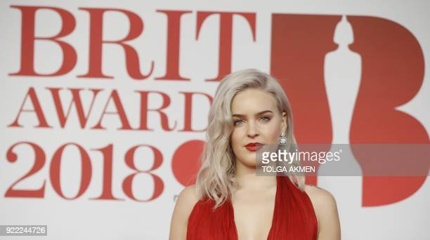 British singersongwriter AnneMarie poses on the red carpet on arrival for the BRIT Awards 2018 in London on February 21 2018 / AFP PHOTO / Tolga...
