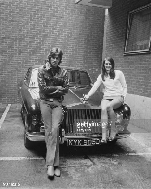 British singer-songwriter Barry Gibb and his girlfriend Linda Gray sit on Gibb's Roll Royce, UK, 28th October 1968.