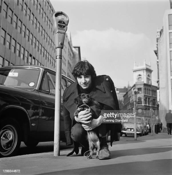 British singer-songwriter Cat Stevens, later Yusuf Islam, with a small dog, UK, 3rd November 1966.
