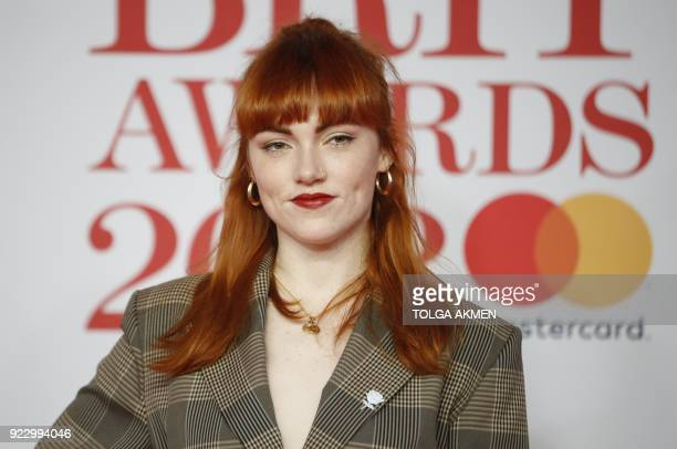 British singersongwriter Chloe Howl poses on the red carpet on arrival for the BRIT Awards 2018 in London on February 21 2018 / AFP PHOTO / Tolga...