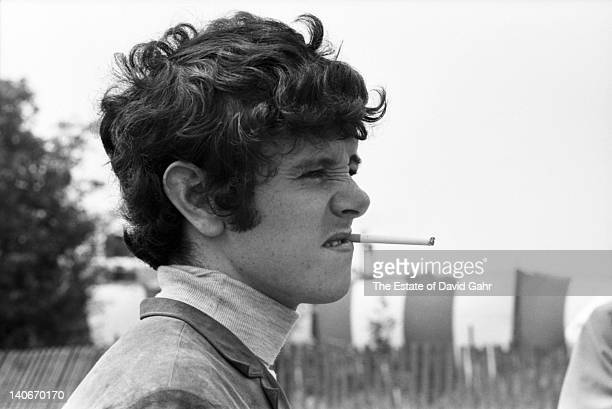 British singersongwriter Donovan arrives for his debut US performance at the Newport Folk Festival in July 1965 in Newport Rhode Island