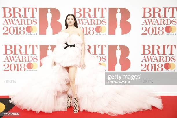 British singersongwriter Dua Lipa poses on the red carpet on arrival for the BRIT Awards 2018 in London on February 21 2018 / AFP PHOTO / Tolga AKMEN...