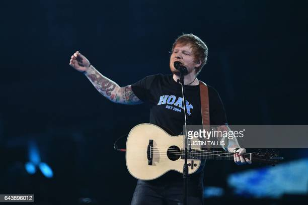 British singersongwriter Ed Sheeran performs during the BRIT Awards 2017 ceremony and live show in London on February 22 2017 / AFP / Justin TALLIS /...