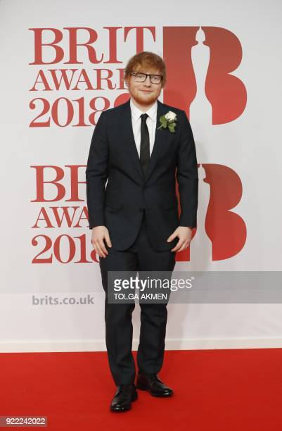 British singersongwriter Ed Sheeran poses on the red carpet on arrival for the BRIT Awards 2018 in London on February 21 2018 / AFP PHOTO / Tolga...