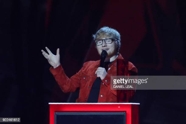 British singersongwriter Ed Sheeran speaks as he collects his Global Success award during the BRIT Awards 2018 ceremony and live show in London on...