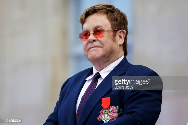 British singer-songwriter Elton John addresses a crowd in the courtyard of the Elysee Palace in Paris, on June 21 as part of a ceremony in which he...