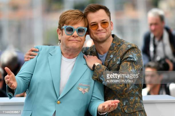 TOPSHOT British singersongwriter Elton John and British actor Taron Egerton pose during a photocall for the film Rocketman at the 72nd edition of the...