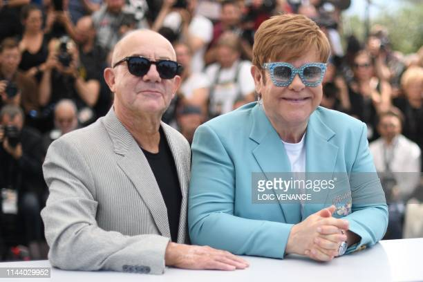 British singersongwriter Elton John and British screenwriter Bernie taupin pose during a photocall for the film Rocketman at the 72nd edition of the...