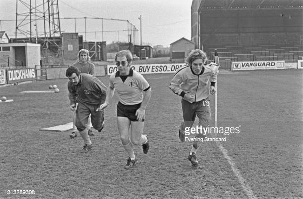 British singer-songwriter Elton John and singer Rod Stewart training at Vicarage Road in Watford, 7th November 1973. Elton John is vice-president of...