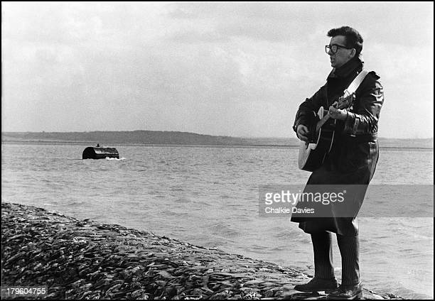 British singersongwriter Elvis Costello performing by the sea at Canvey Island Essex during the making of a video for 'New Amsterdam' from the LP...