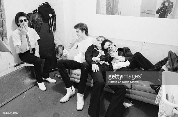 British singersongwriter Elvis Costello with his backing band The Attractions backstage during their US tour 1979