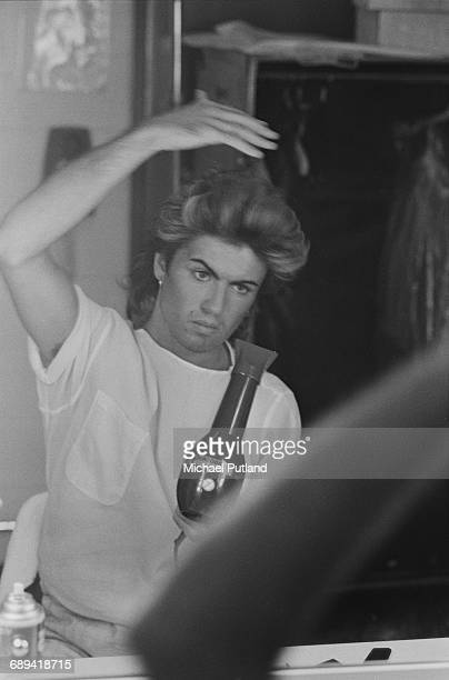 British singersongwriter George Michael of Wham blow drying his hair during the pop duo's 1985 world tour January 1985'The Big Tour' took in the UK...