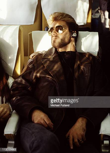 British singersongwriter George Michael relaxes on board a bullet train Japan 1988