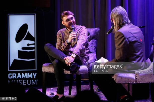 British singersongwriter James Arthur and Vice President of The GRAMMY Foundation MusiCares Scott Goldman speak onstage during Spotlight James Arthur...