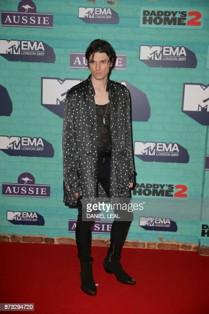 British singer-songwriter James Bay poses on the red carpet arriving to attend the 2017 MTV Europe Music Awards at Wembley Arena in London on...