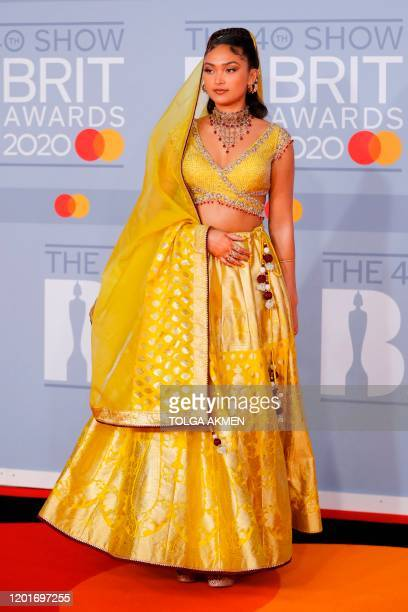 British singersongwriter Joy Crookes poses on the red carpet on arrival for the BRIT Awards 2020 in London on February 18 2020 / RESTRICTED TO...