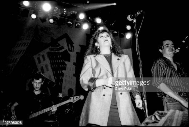 British singer-songwriter Kirsty MacColl performing with The Pogues at the Town and Country Club, London, March 1988. On the left is Darryl Hunt and...