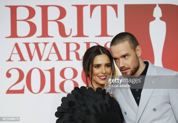 British singersongwriter Liam Payne and partner Cheryl pose on the red carpet on arrival for the BRIT Awards 2018 in London on February 21 2018 / AFP...