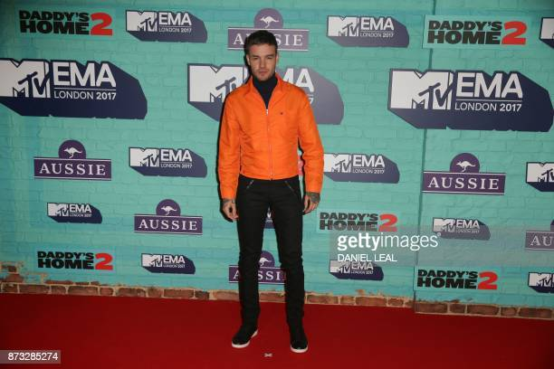 British singersongwriter Liam Payne poses on the red carpet arriving to attend the 2017 MTV Europe Music Awards at Wembley Arena in London on...