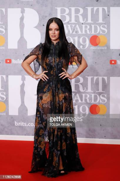 British singersongwriter Lily Allen poses on the red carpet on arrival for the BRIT Awards 2019 in London on February 20 2019 / RESTRICTED TO...