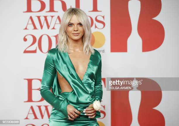 British singersongwriter Louisa Johnson poses on the red carpet on arrival for the BRIT Awards 2018 in London on February 21 2018 / AFP PHOTO / Tolga...