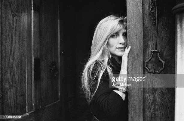 British singersongwriter Lynsey de Paul poses against a door frame with a large ring door knocker at her home in Highgate London England 25th January...
