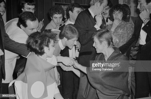 British singer-songwriter, musician and actor David Bowie greeting fans at the premiere party for 'Just a Gigolo' with fashion model Viv Lynn, at the...