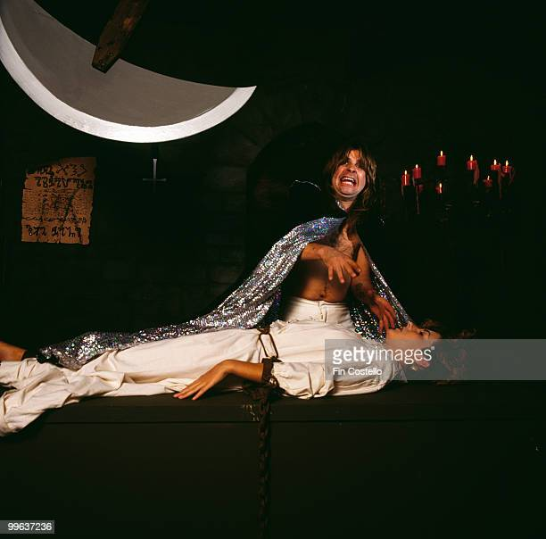British singersongwriter Ozzy Osbourne poses with a chained woman beneath a sharpened pendulum during the 'Diary Of A Madman' album cover shoot...