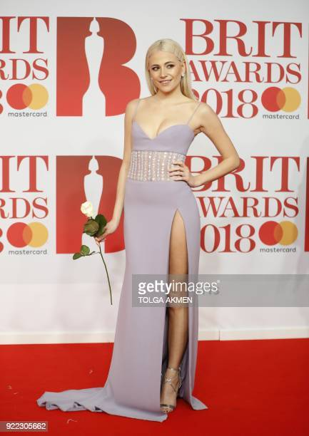 British singersongwriter Pixie Lott poses on the red carpet on arrival for the BRIT Awards 2018 in London on February 21 2018 / AFP PHOTO / Tolga...