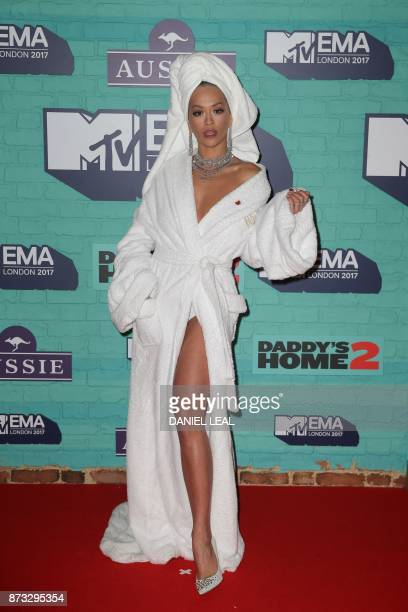 TOPSHOT British singersongwriter Rita Ora poses on the red carpet arriving to attend the 2017 MTV Europe Music Awards at Wembley Arena in London on...