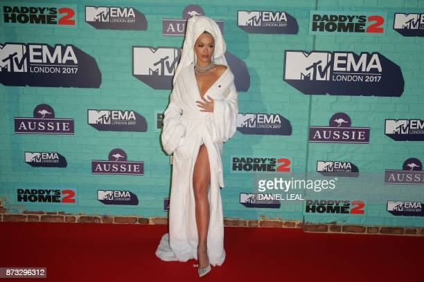 British singersongwriter Rita Ora poses on the red carpet arriving to attend the 2017 MTV Europe Music Awards at Wembley Arena in London on November...