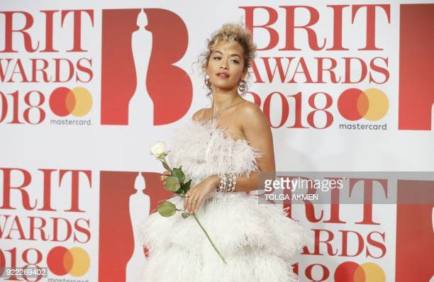 TOPSHOT British singersongwriter Rita Ora poses on the red carpet on arrival for the BRIT Awards 2018 in London on February 21 2018 / RESTRICTED TO...