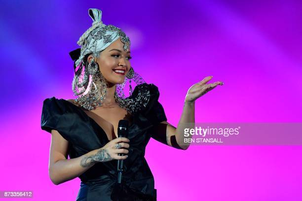 TOPSHOT British singersongwriter Rita Ora presents during the 2017 MTV Europe Music Awards at Wembley Arena in London on November 12 2017 / AFP PHOTO...