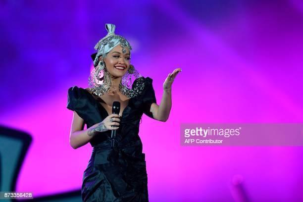 British singersongwriter Rita Ora presents during the 2017 MTV Europe Music Awards at Wembley Arena in London on November 12 2017 / AFP PHOTO / Ben...